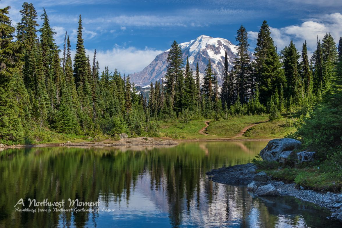Mt Rainier stands tall above Eunice Lake in the early evening of a bright August day.