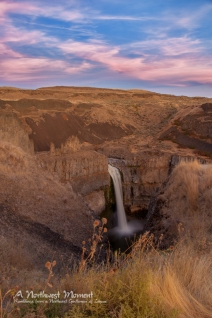 Clouds above Palouse Falls take on a rosey hue during a late September evening.